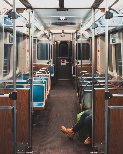 Man Sitting Alone Inside Train