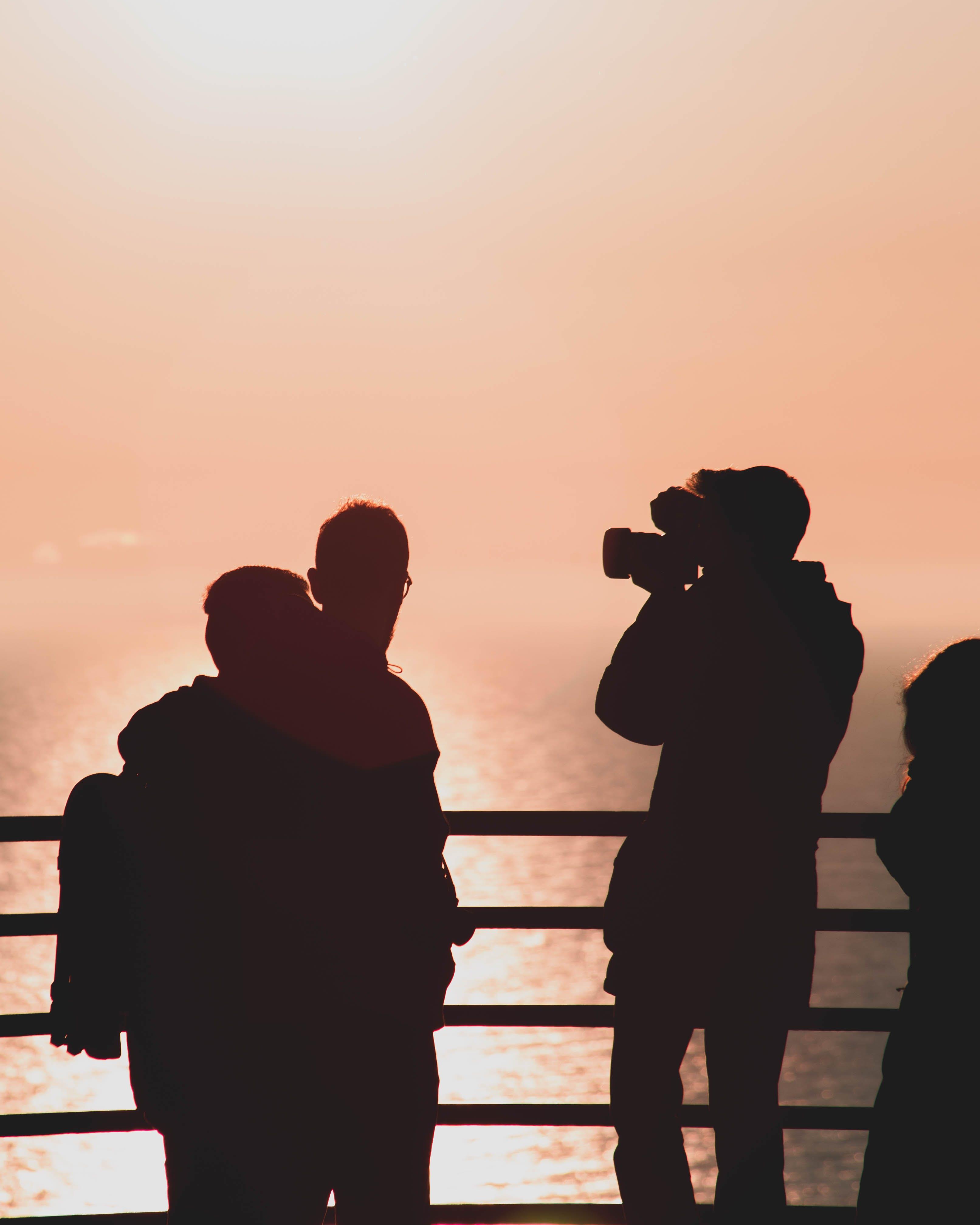 Silhouette Of Man Using Camera