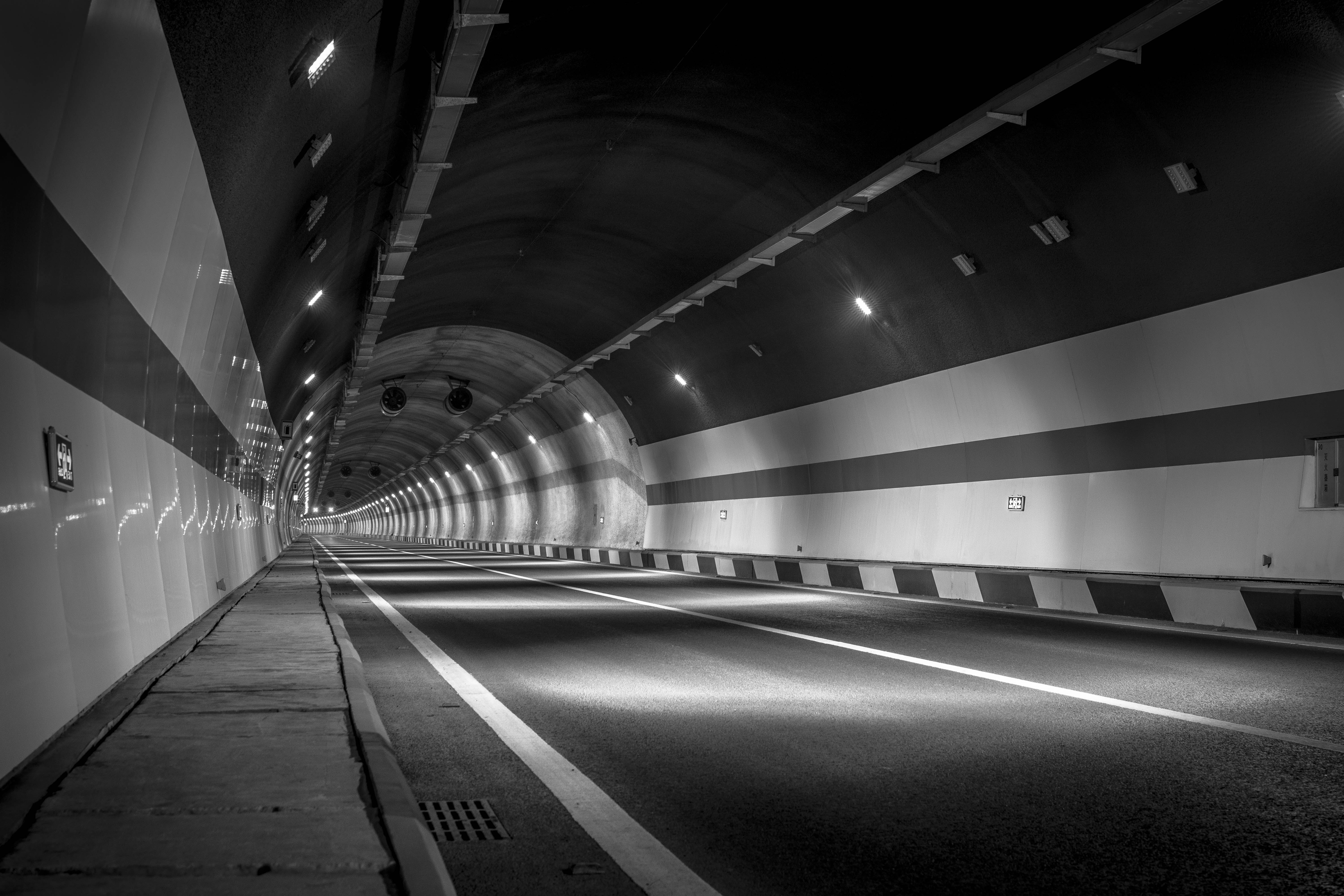 Grayscale Photography of Empty Tunnel