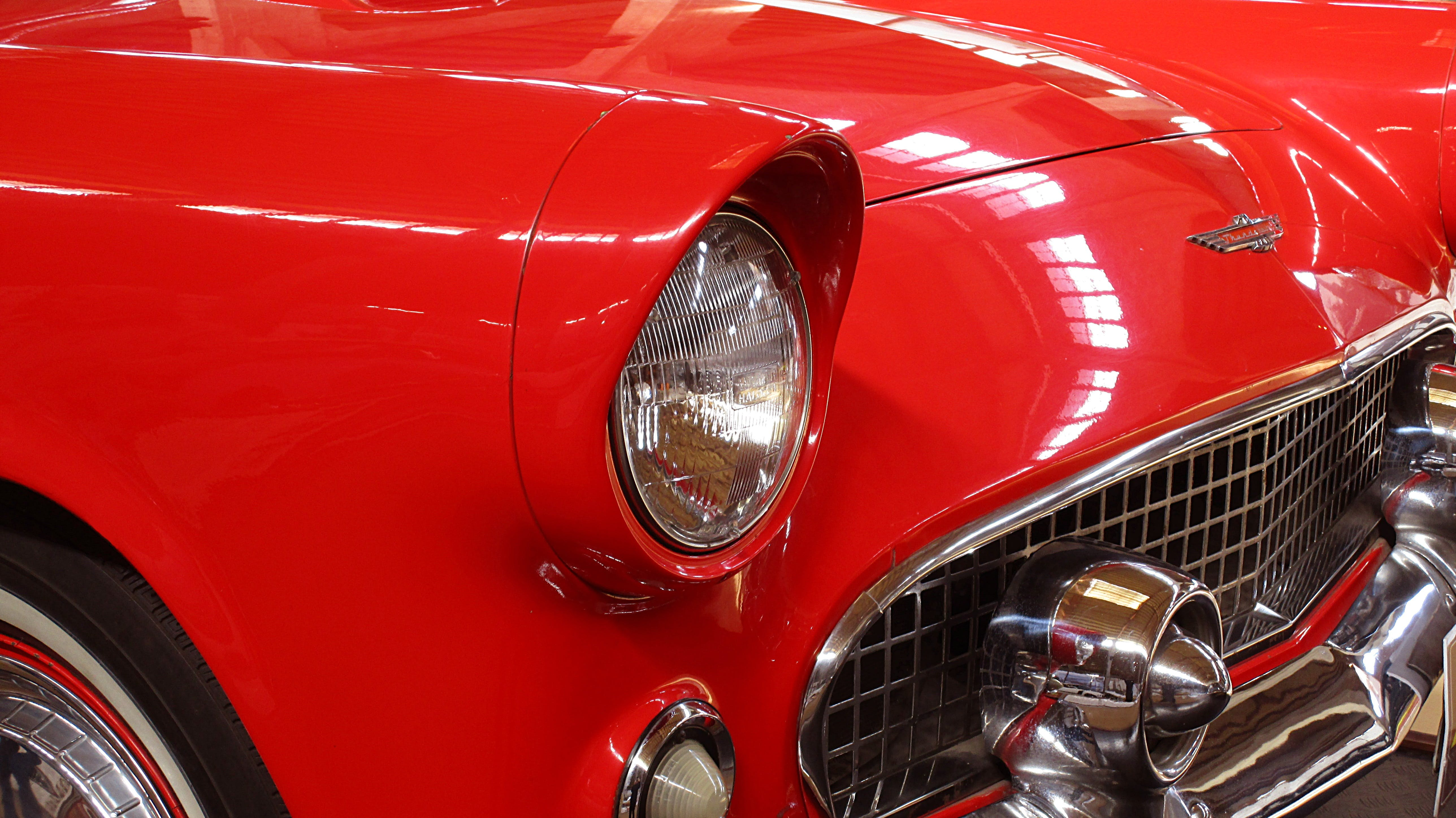 Classic Red Vehicle in Close-up Photography