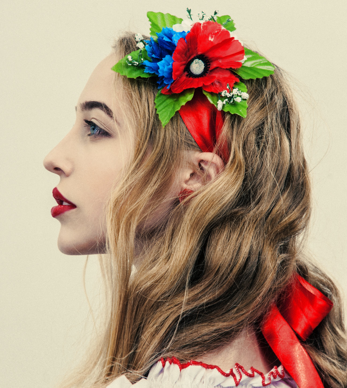 Woman Wearing Floral Headband Facing Sideways