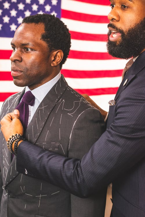 Man Holding Another Man's Purple Necktie