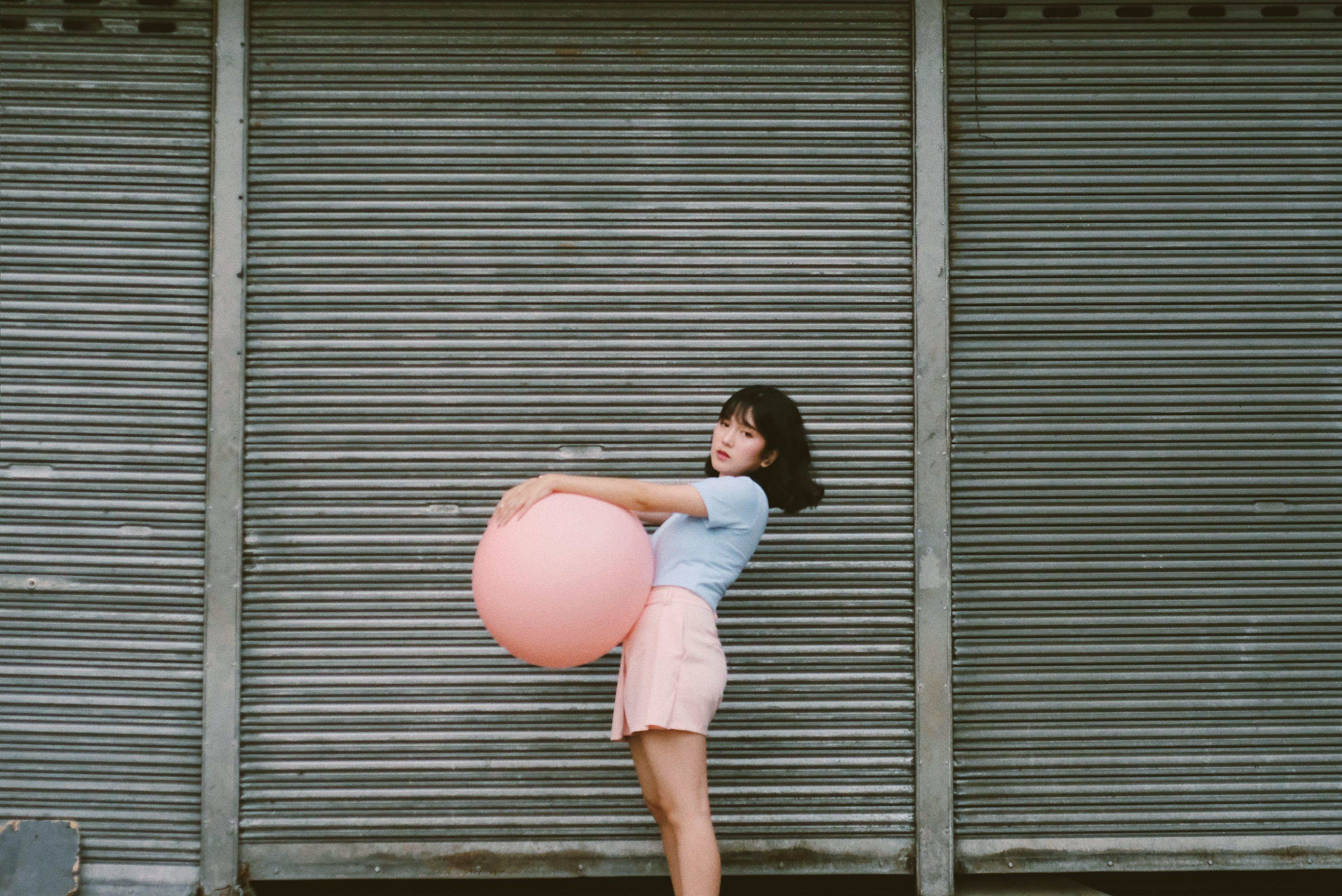 Woman Holding Pink Balloon