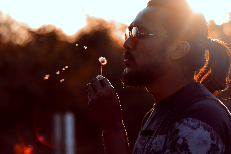 Man Blowing Dadelion