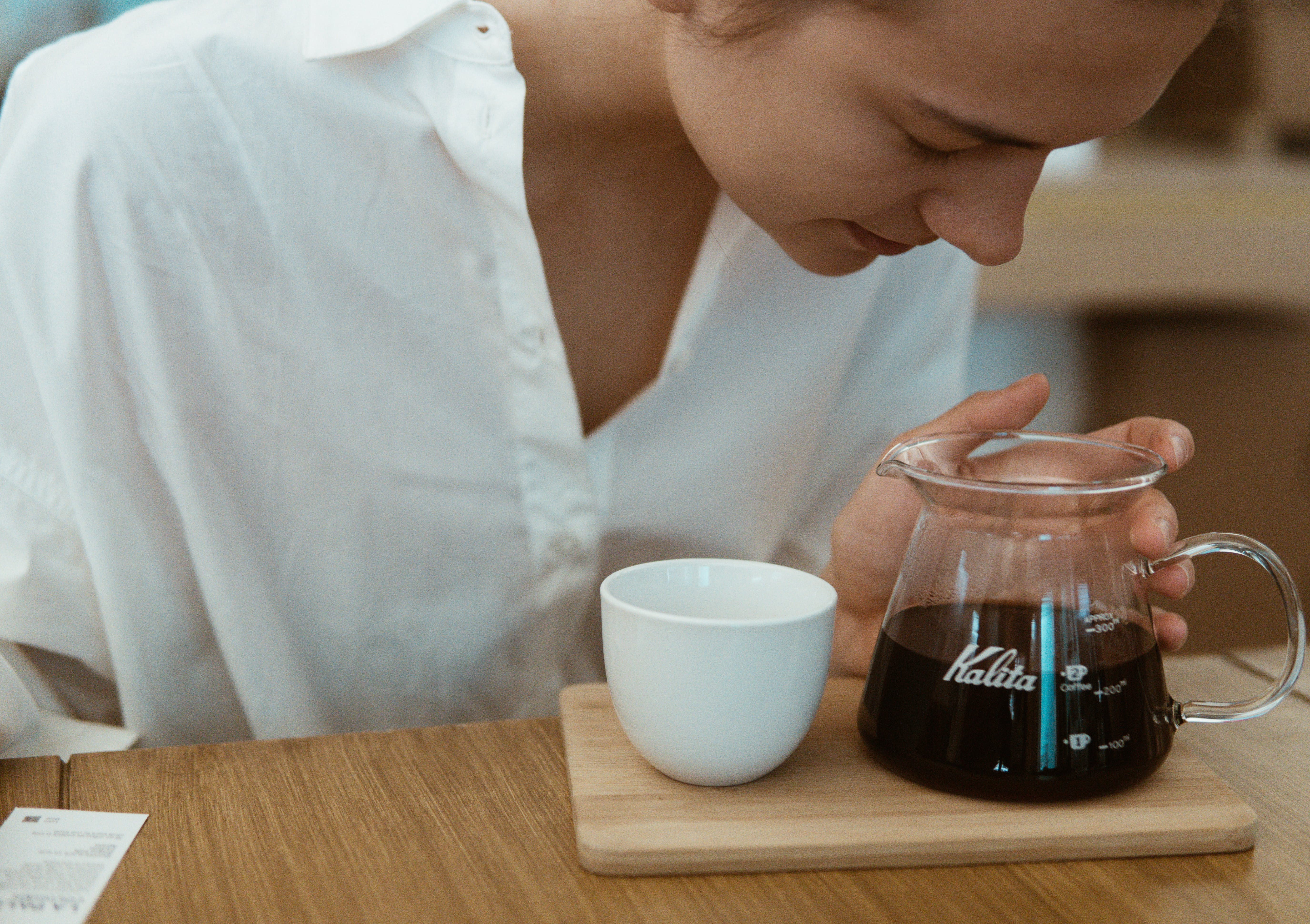 Woman Looking At Black Liquid
