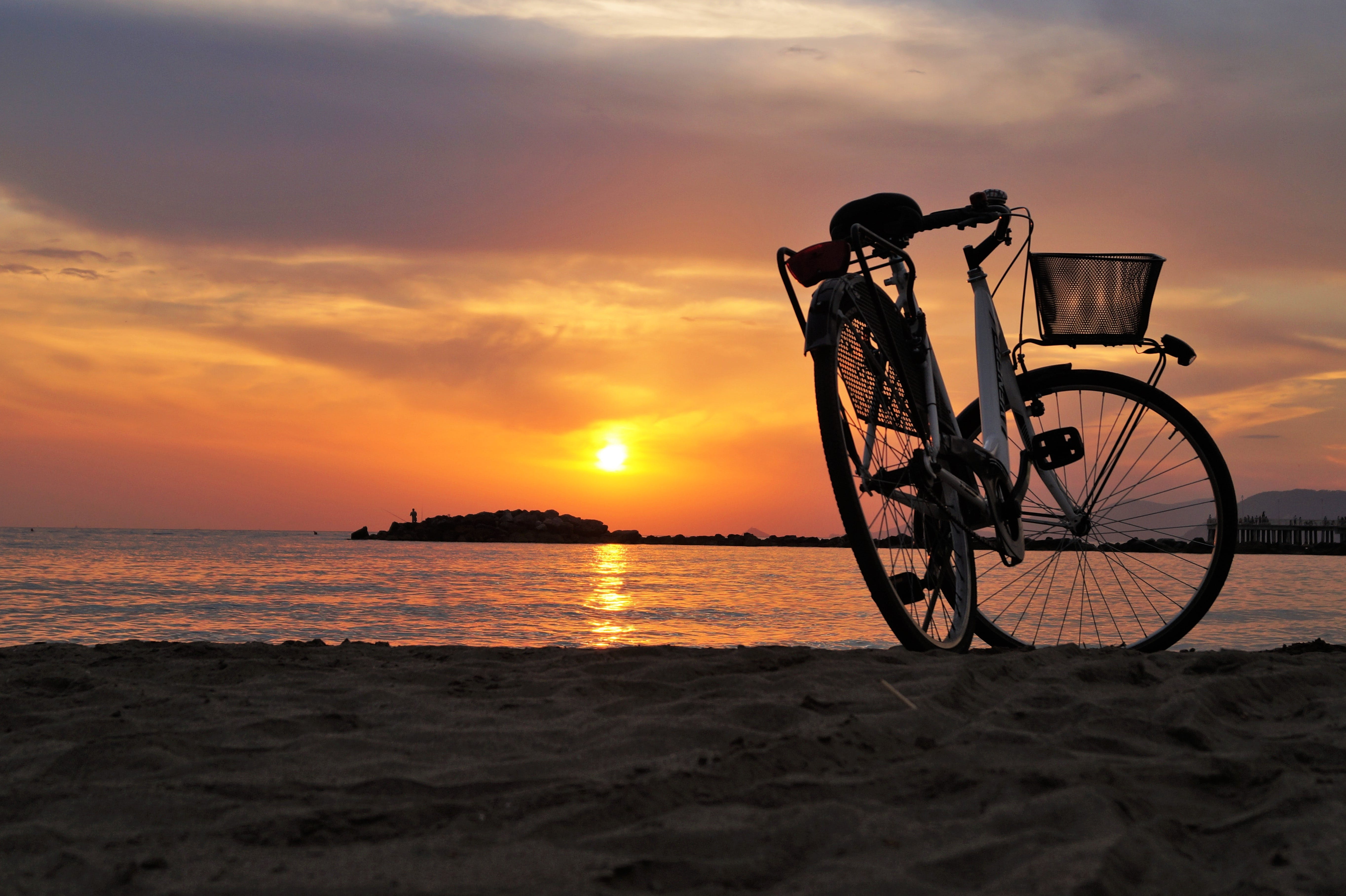 White Hard Tail Bicycle on Brown Beach Sand during Sunsets