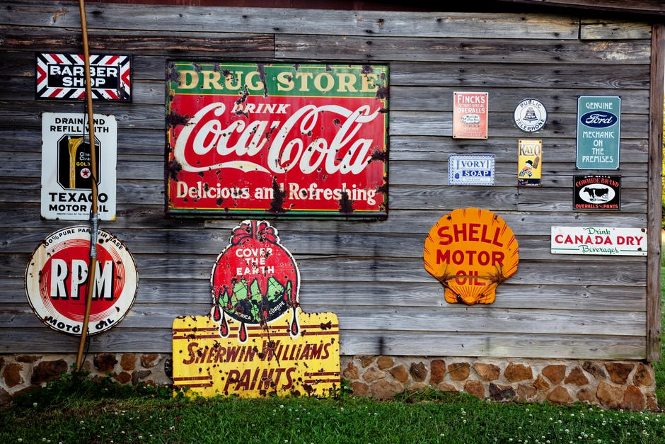 Drug Store Drink Coca Cola Signage on Gray Wooden Wall