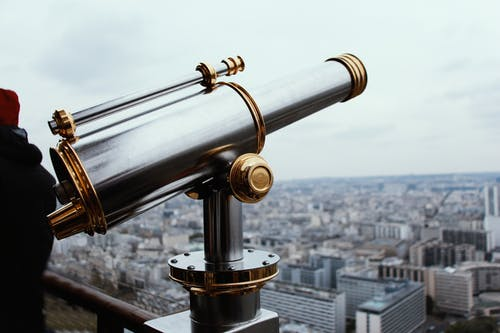 Selective Focus Photography of Gray and Gold-colored Telescope