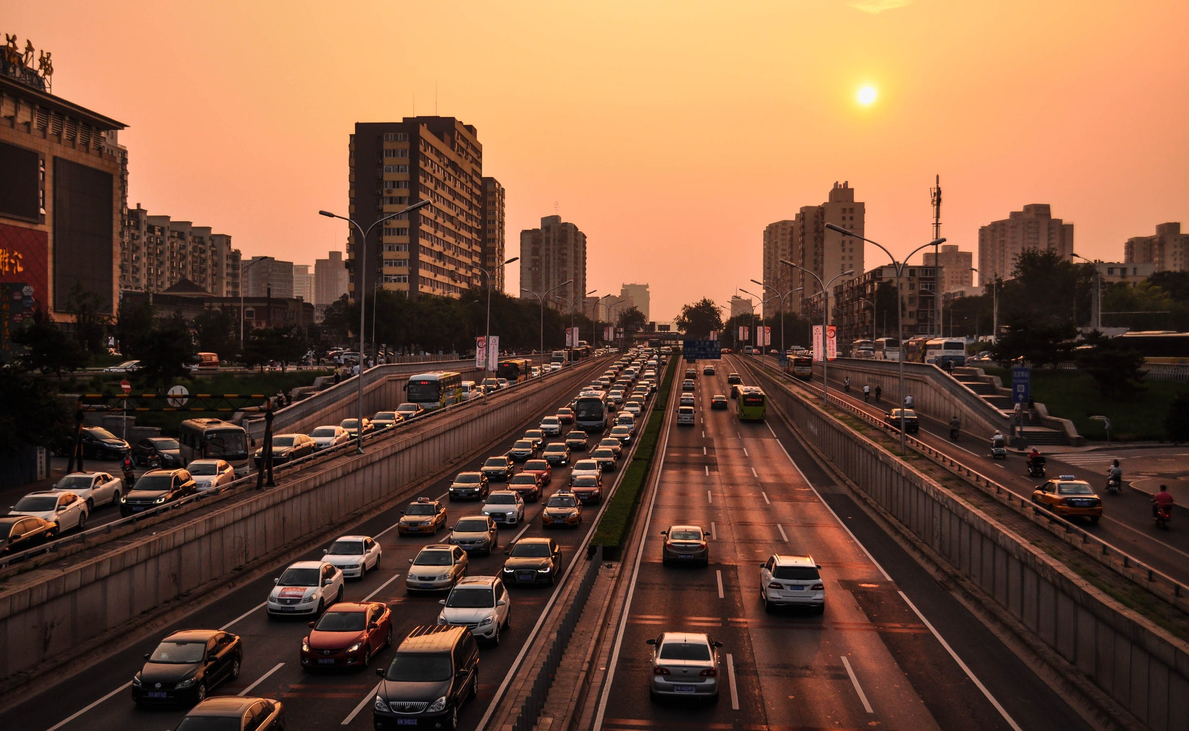 Photos of city sunset with line of cars in traffic