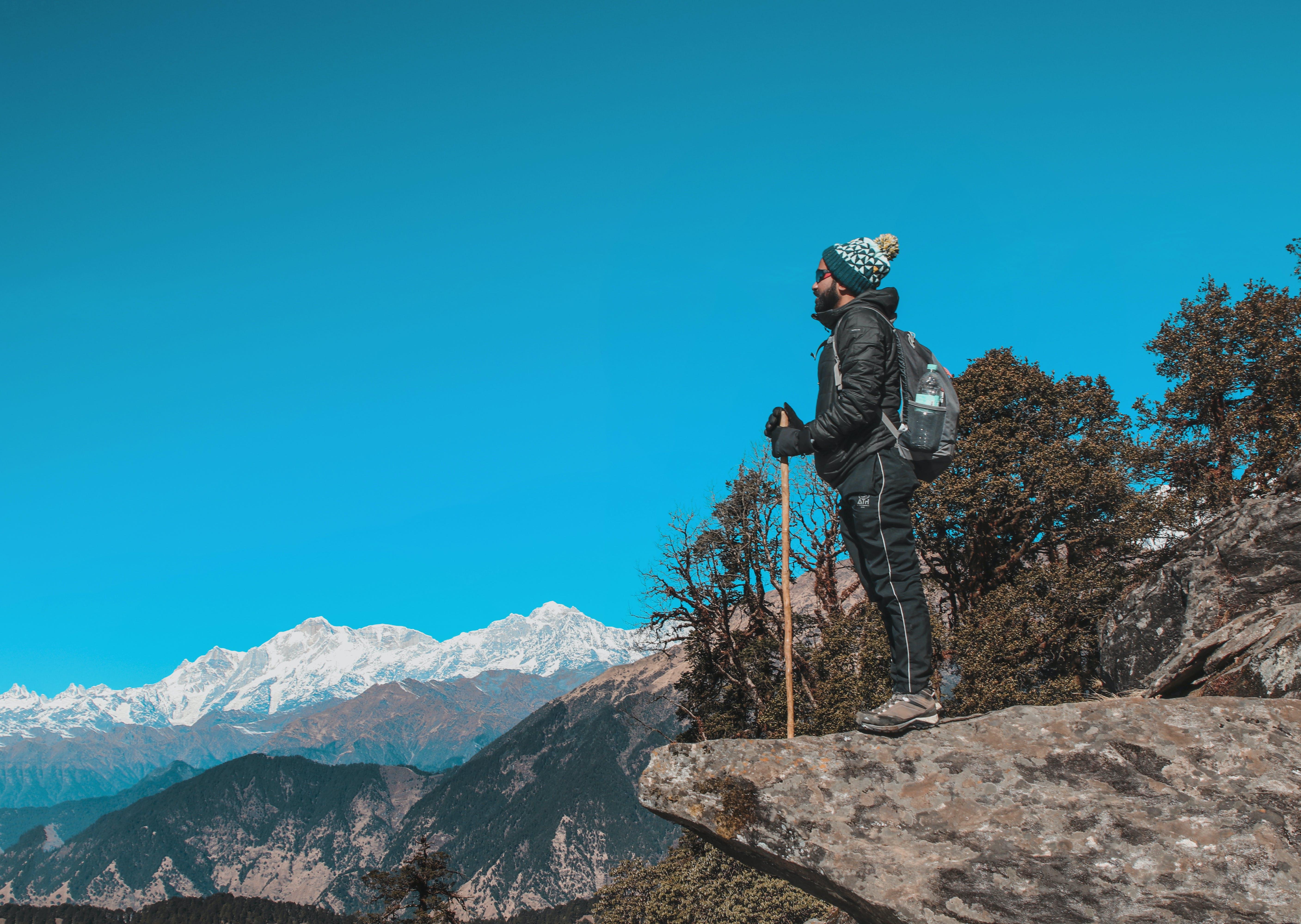 Man Wearing Black Jacket Near Mountain