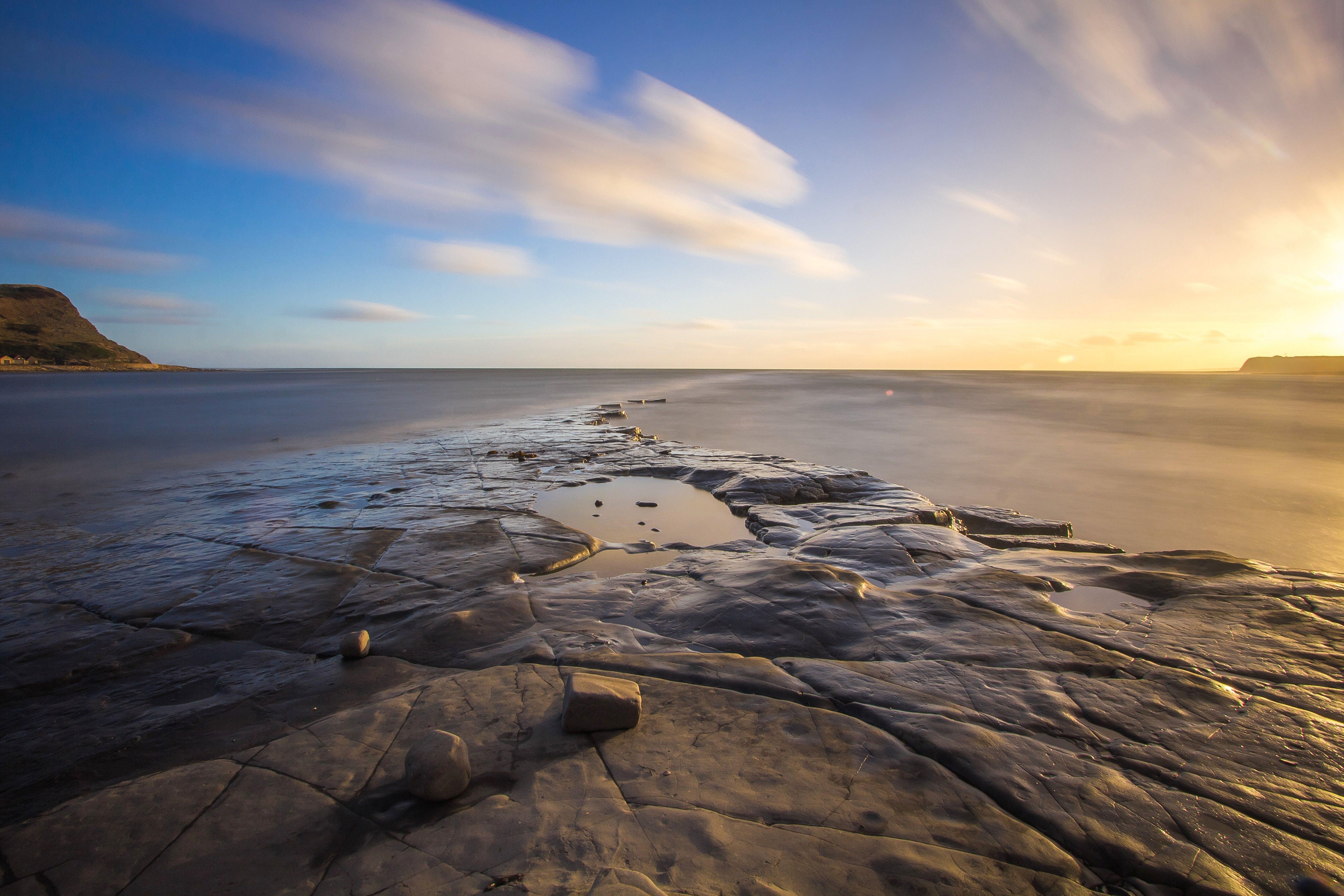 Fotos de stock gratuitas de agua, amanecer, arena, bahía