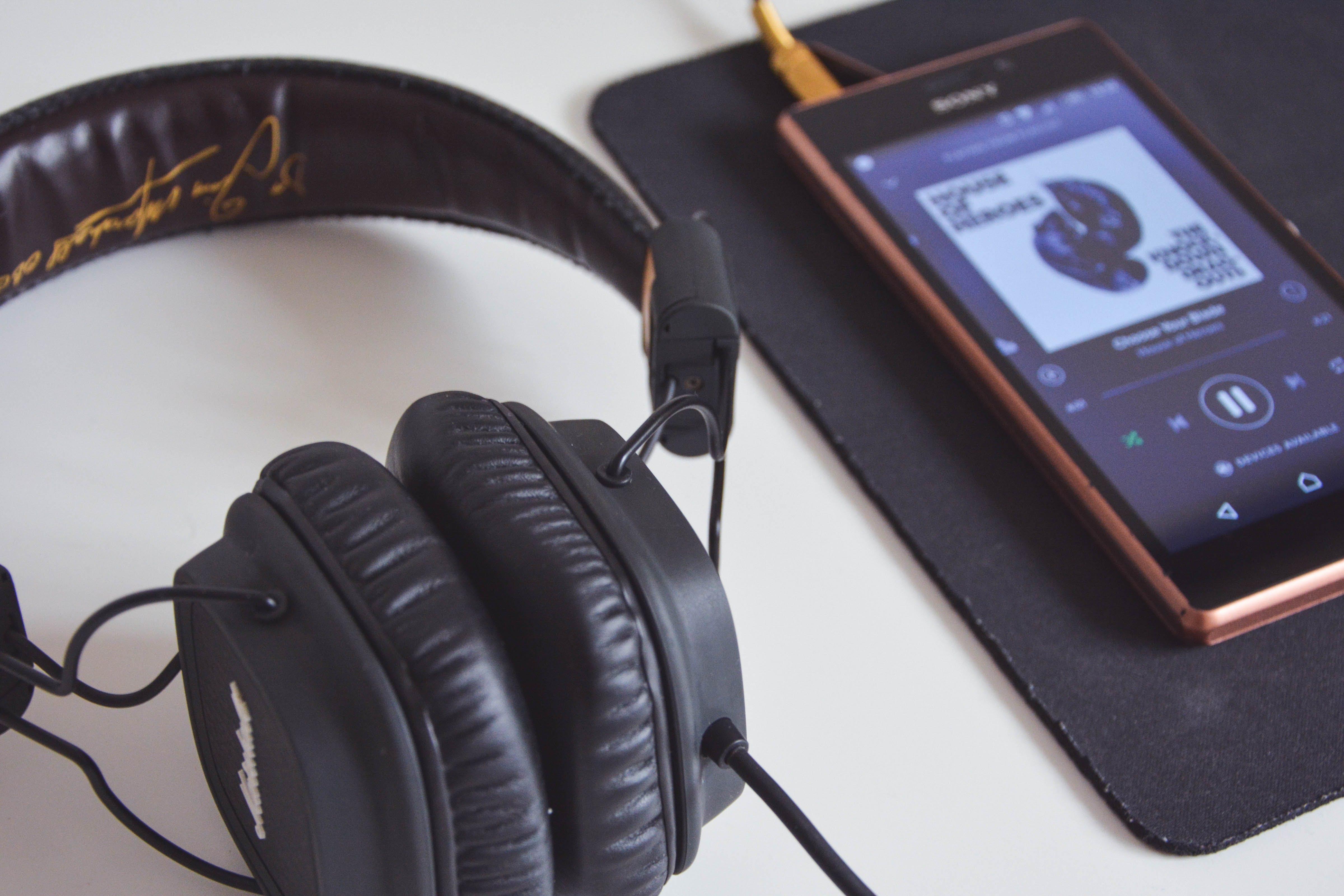 Black Corded Headphones Beside Sony Android Smartphone