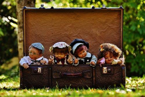 4 Porcelain Dolls in Brown Rectangular Box