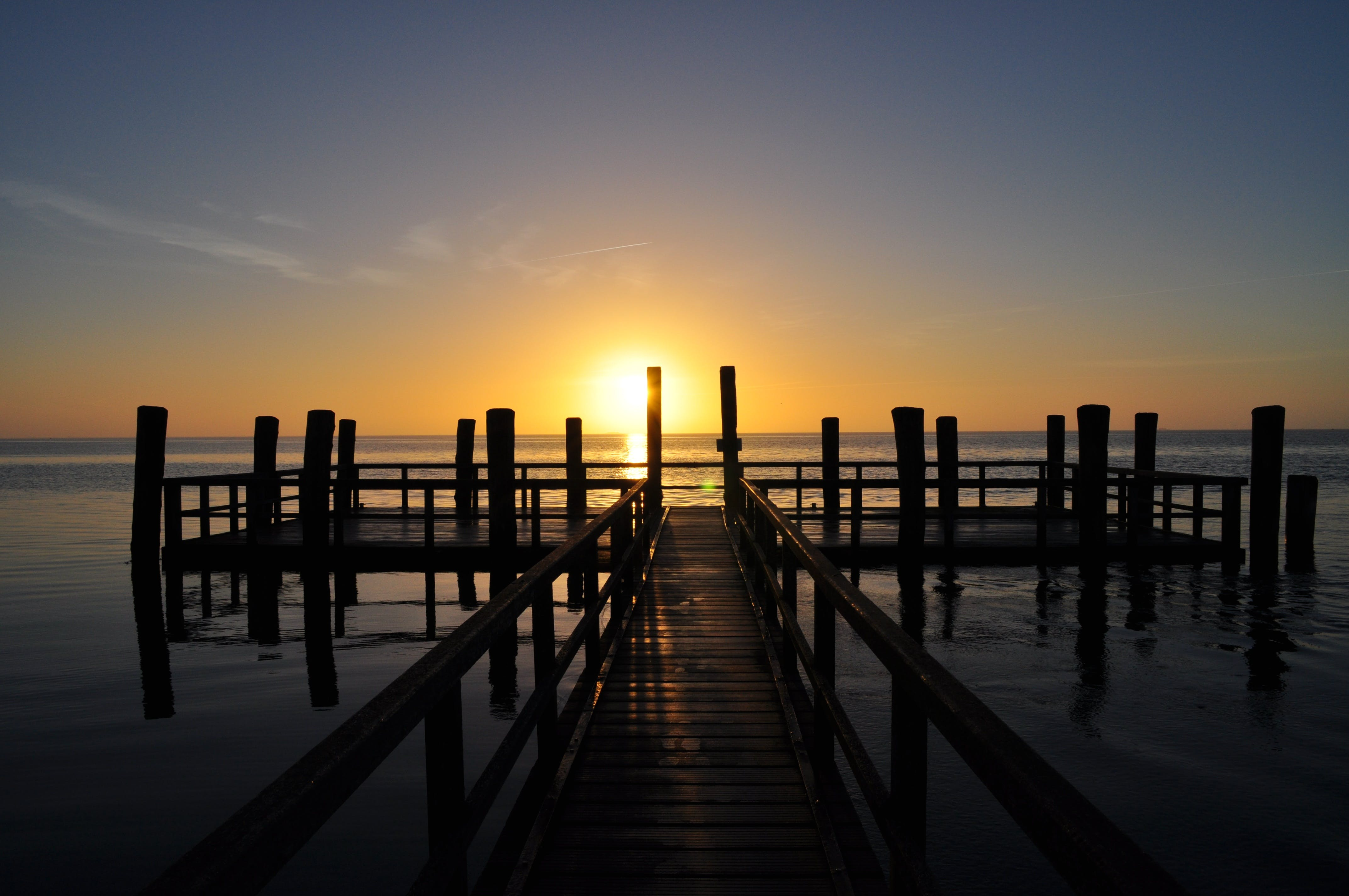 Wood Dock With Sunset Background