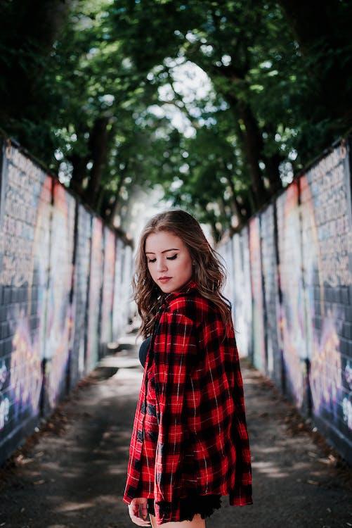 Woman Standing Between Walls