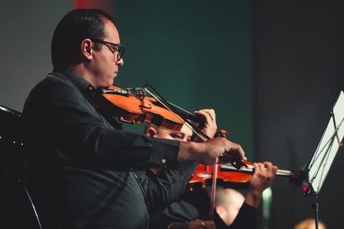 Man Playing Violin on Stage
