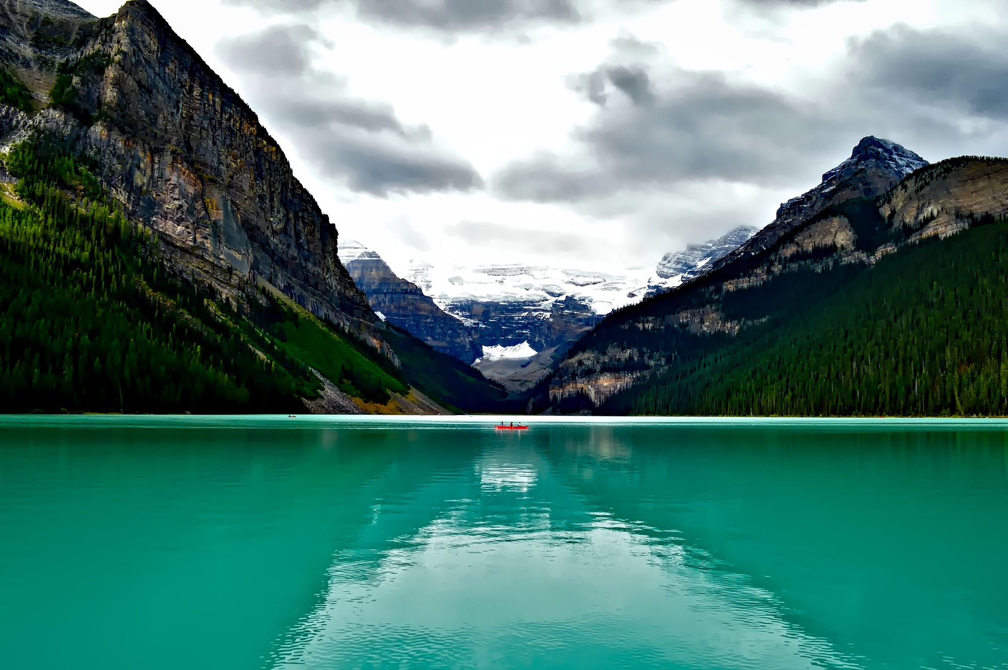 Body of Water Surround by Mountains