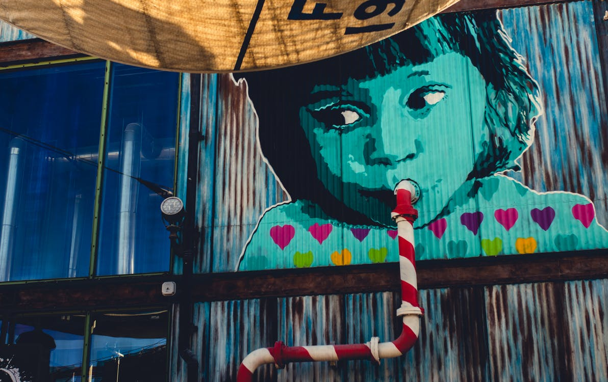 Child Sipping from Pipe Graffiti
