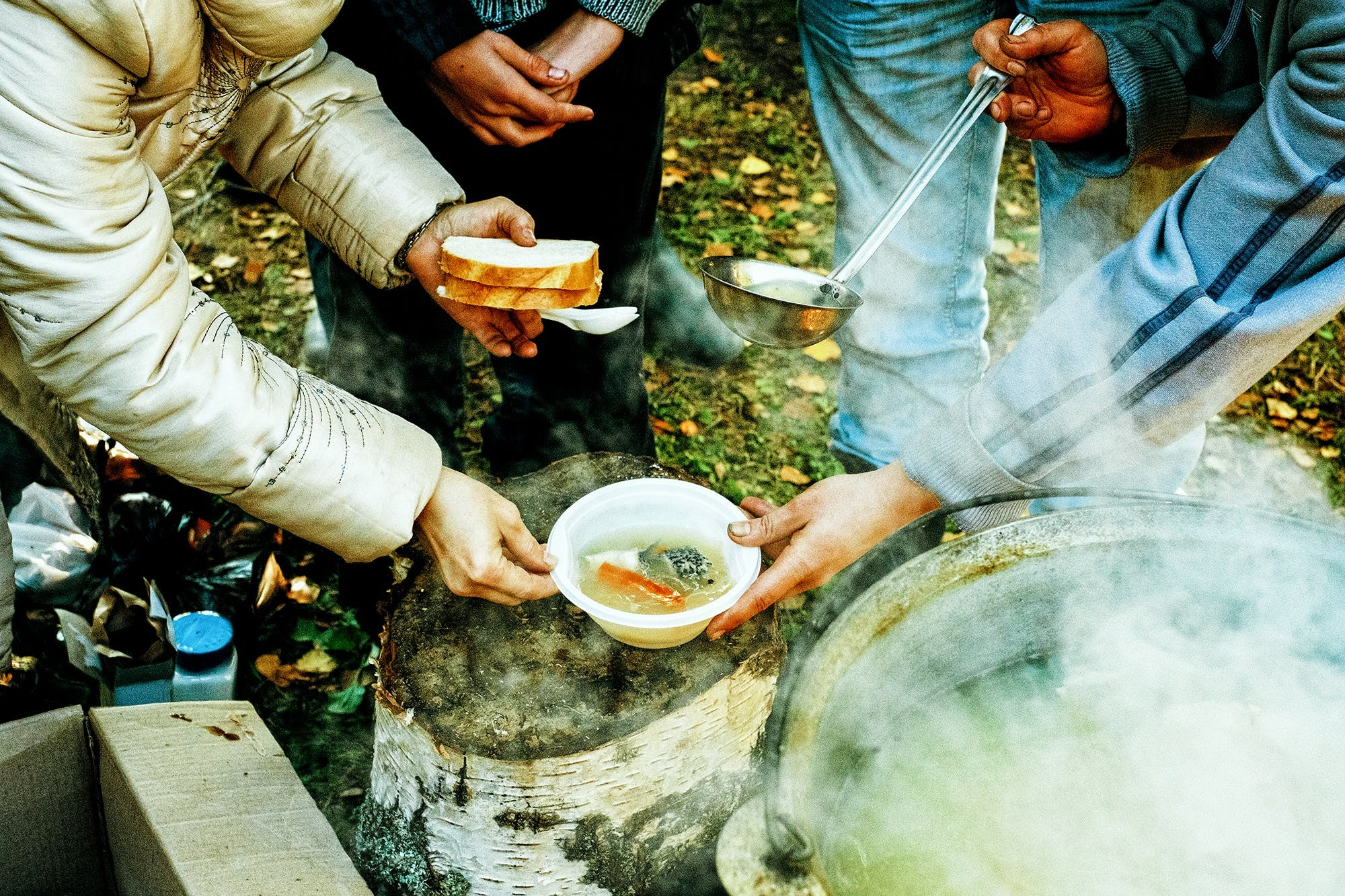People Gathering for Soup and Bread
