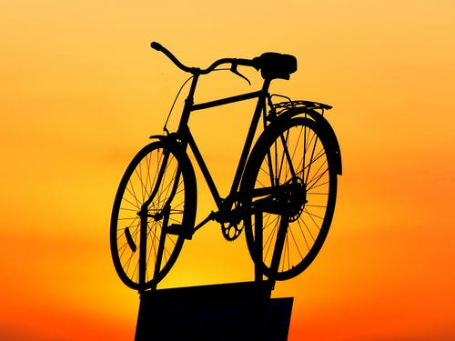 Silhouette of Cruiser Bike during Sunset