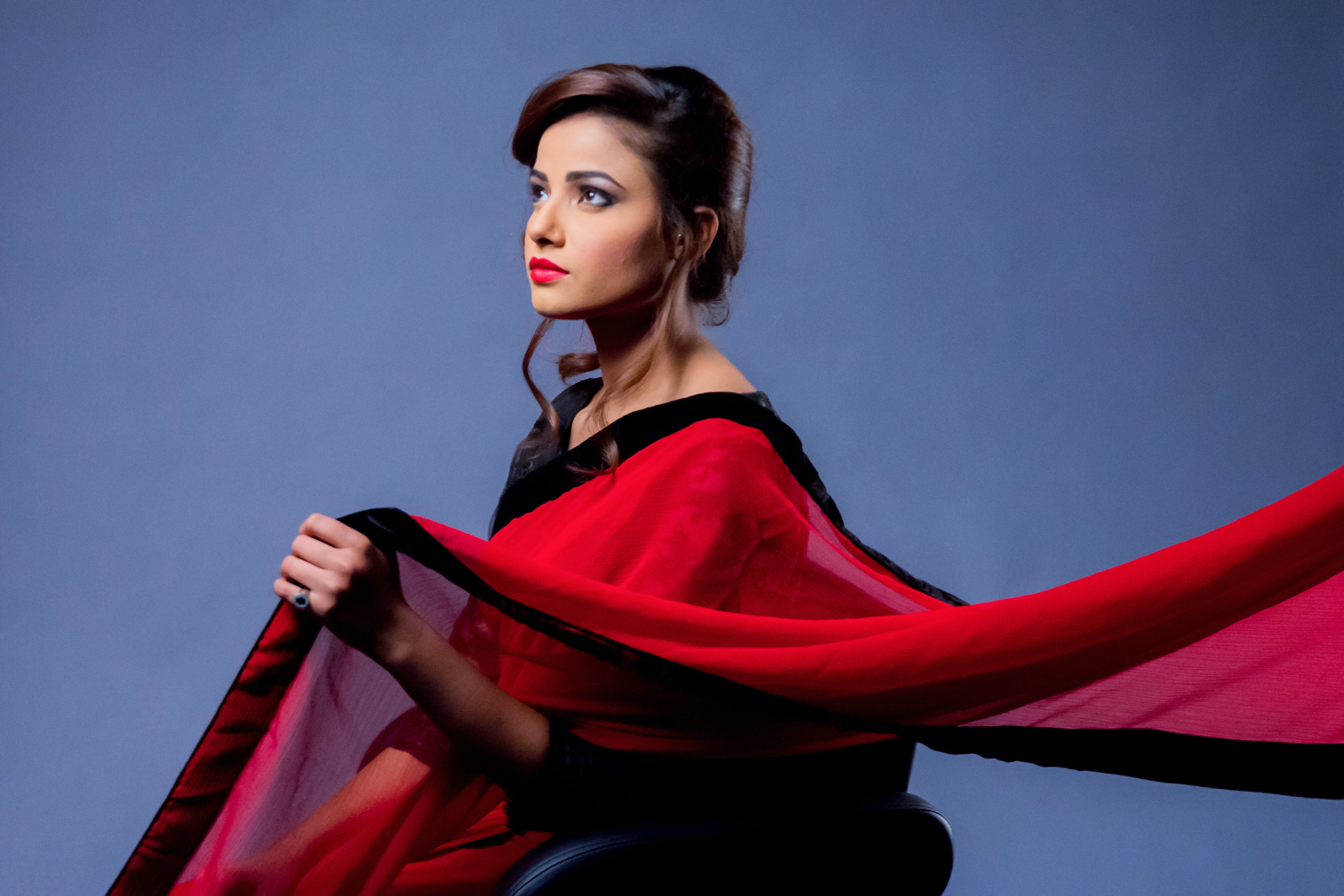 Woman Wearing Red and Black Saree Dress