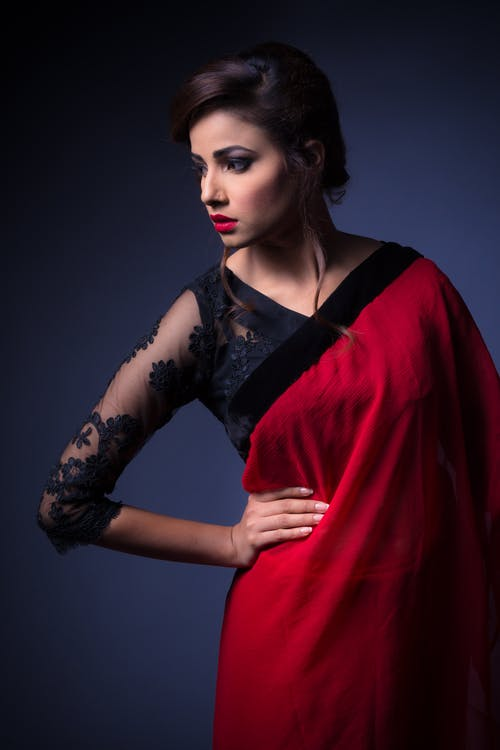 Woman Holding Hip Wearing Red Dress