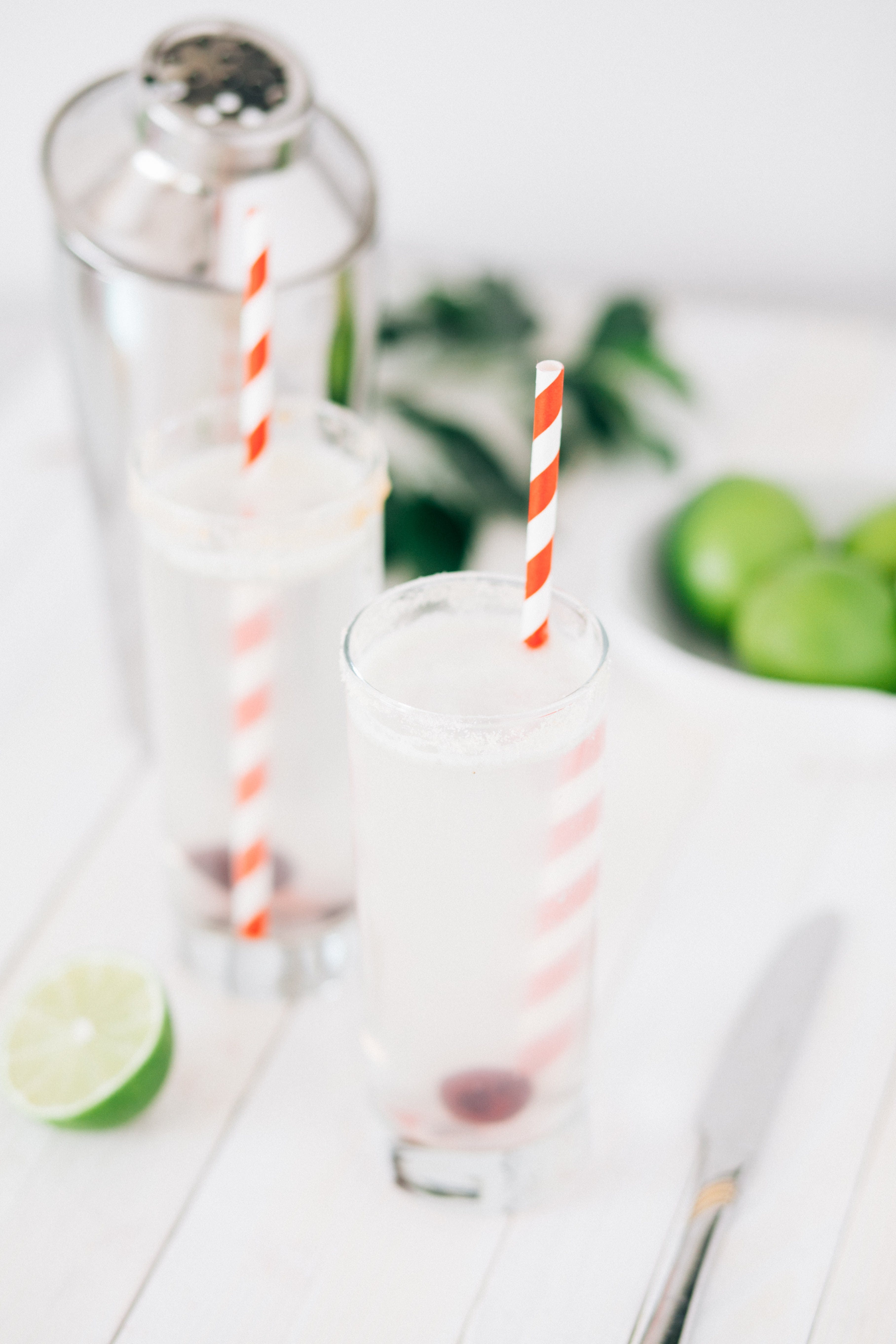 Two Clear Drinking Glasses With Straws