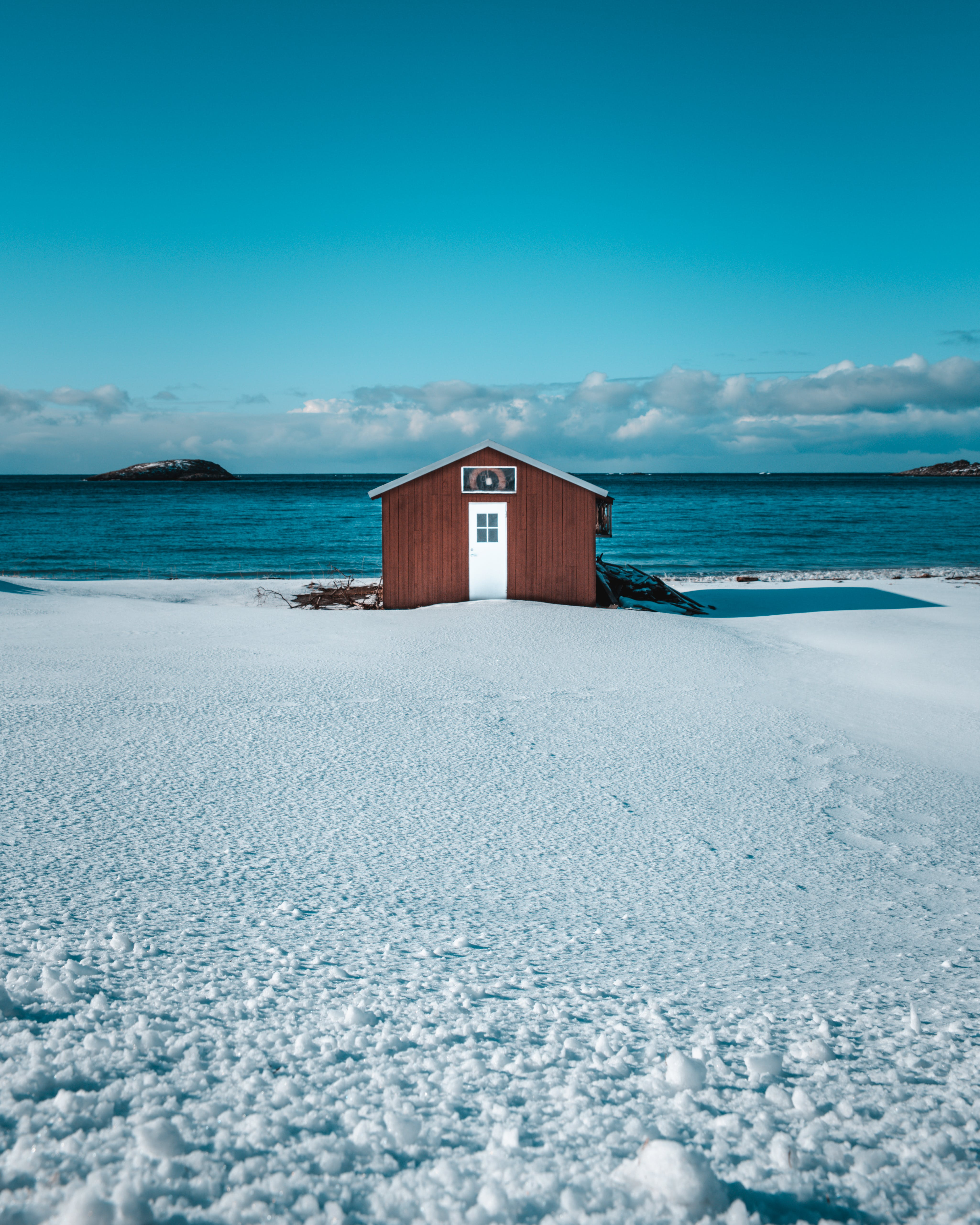 House on Snow Near Body of Water