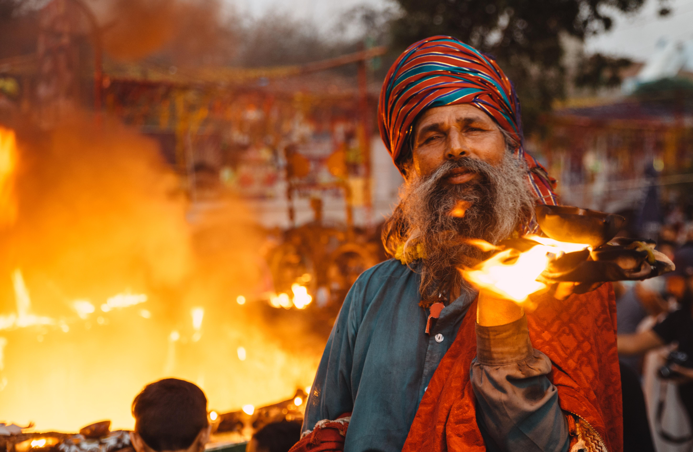 Man Holding Burning Book