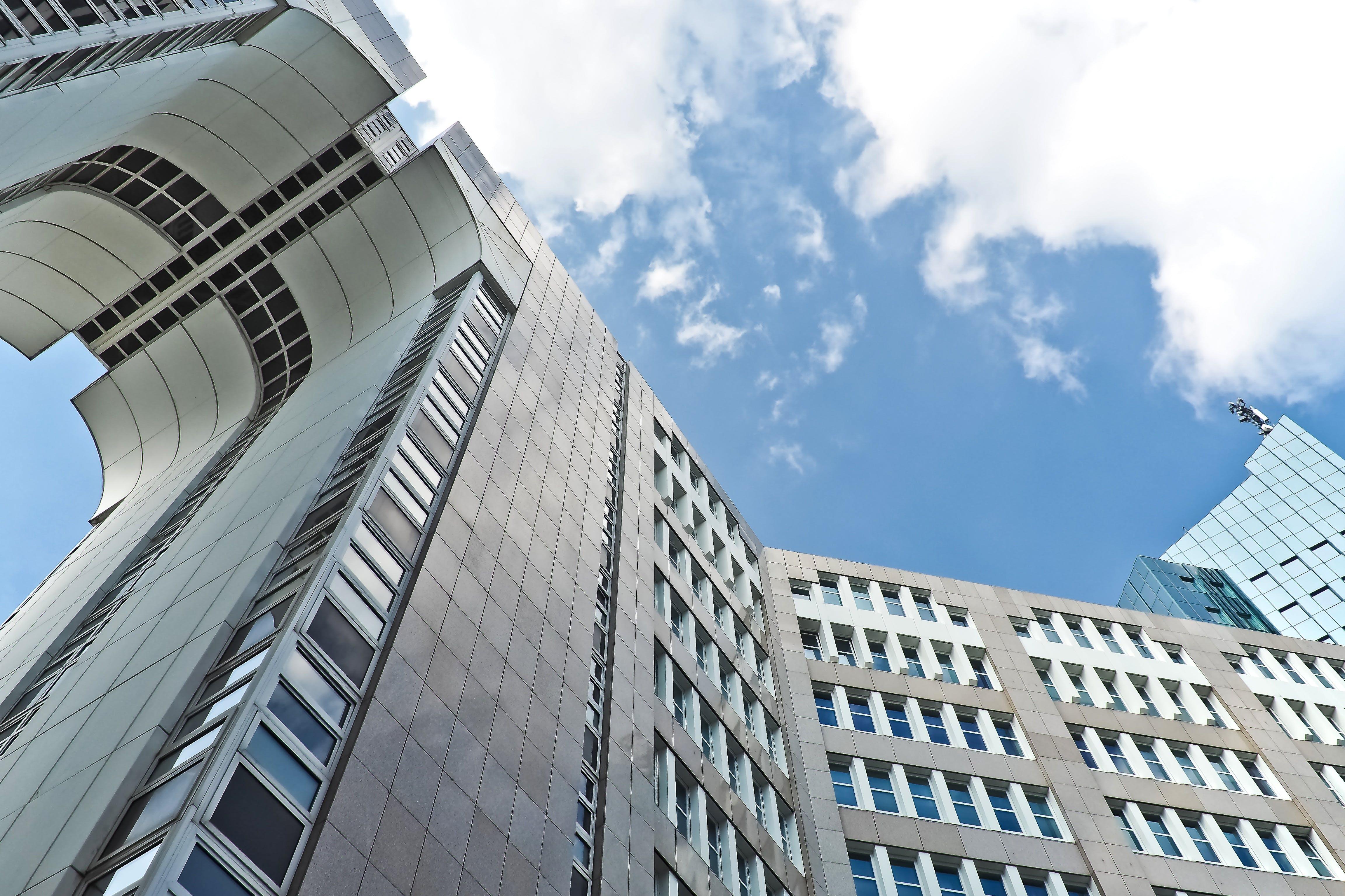 Grey Concrete High Rise Building Under Blue Sky