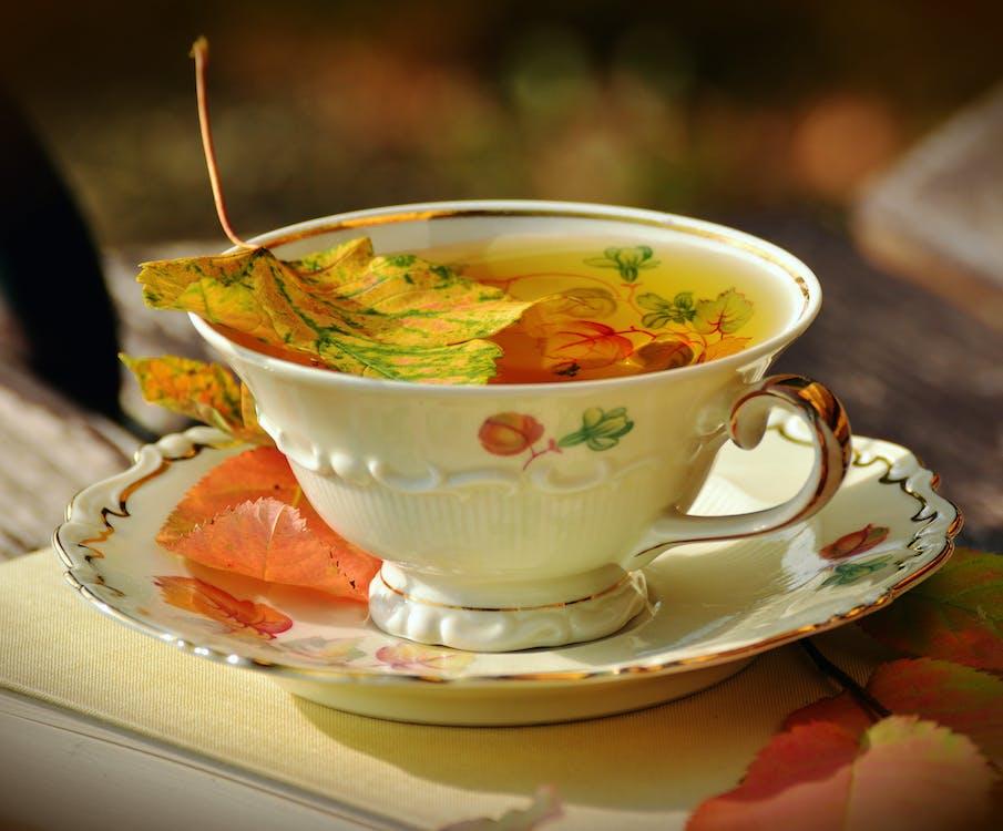 Filled White Teacup on Saucer