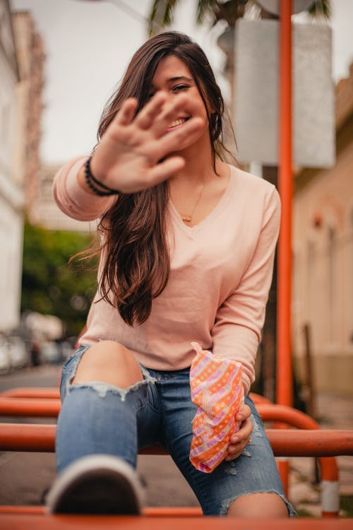 Smiling Woman Covering Her Face