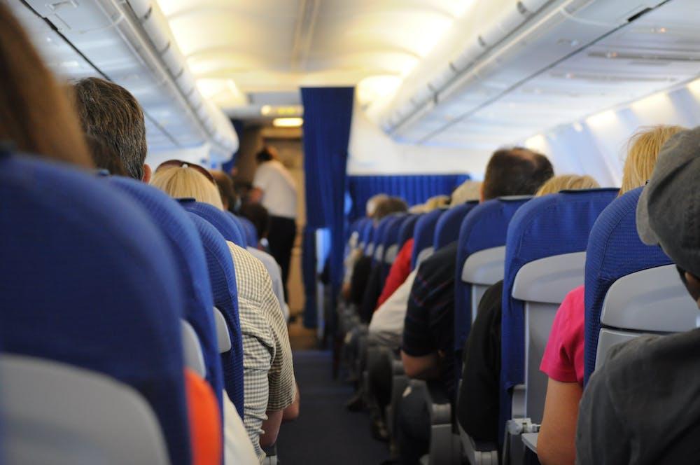 People sitting inside an airplane. | Photo: Pexels