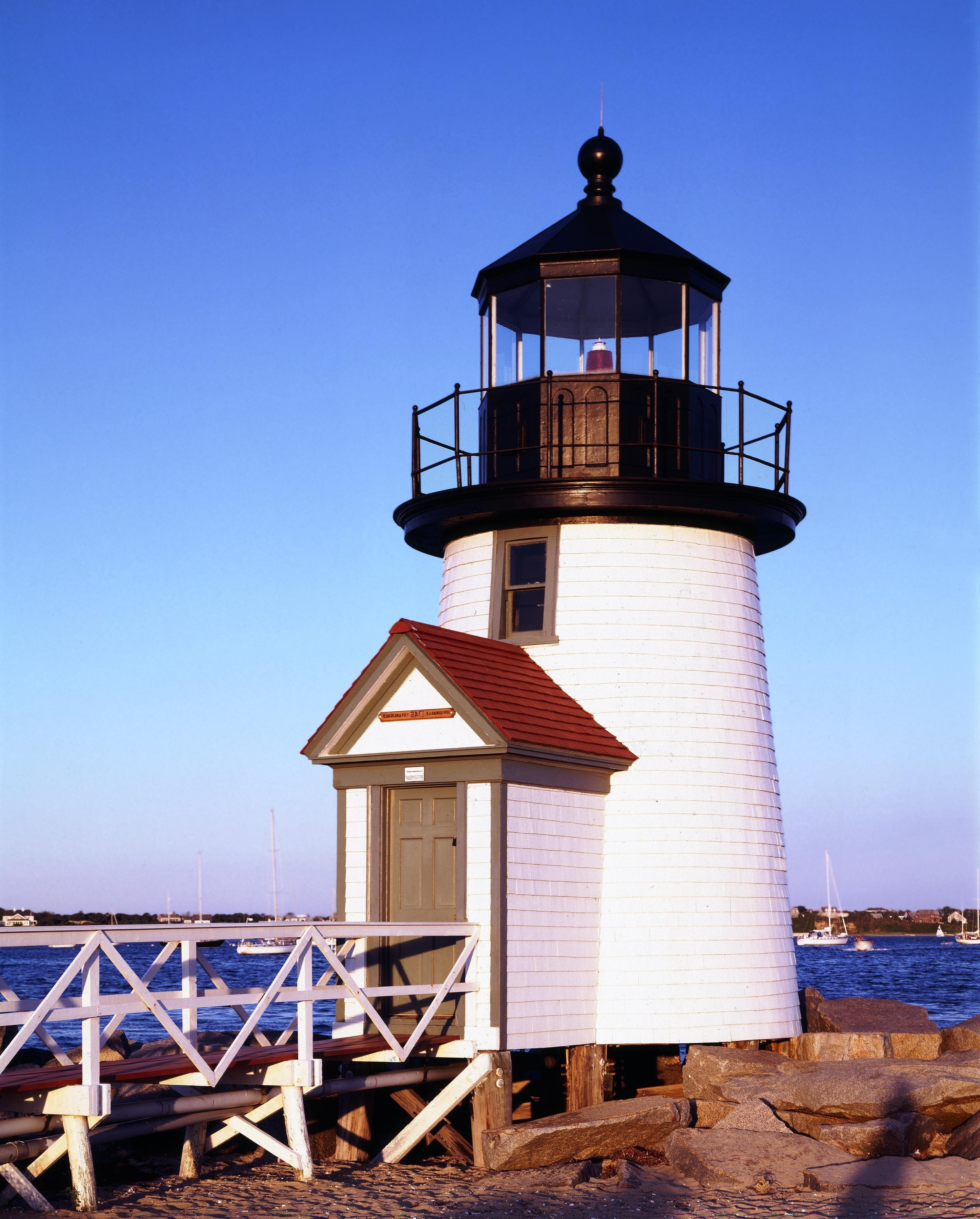 White and Black Lighthouse Near Sea