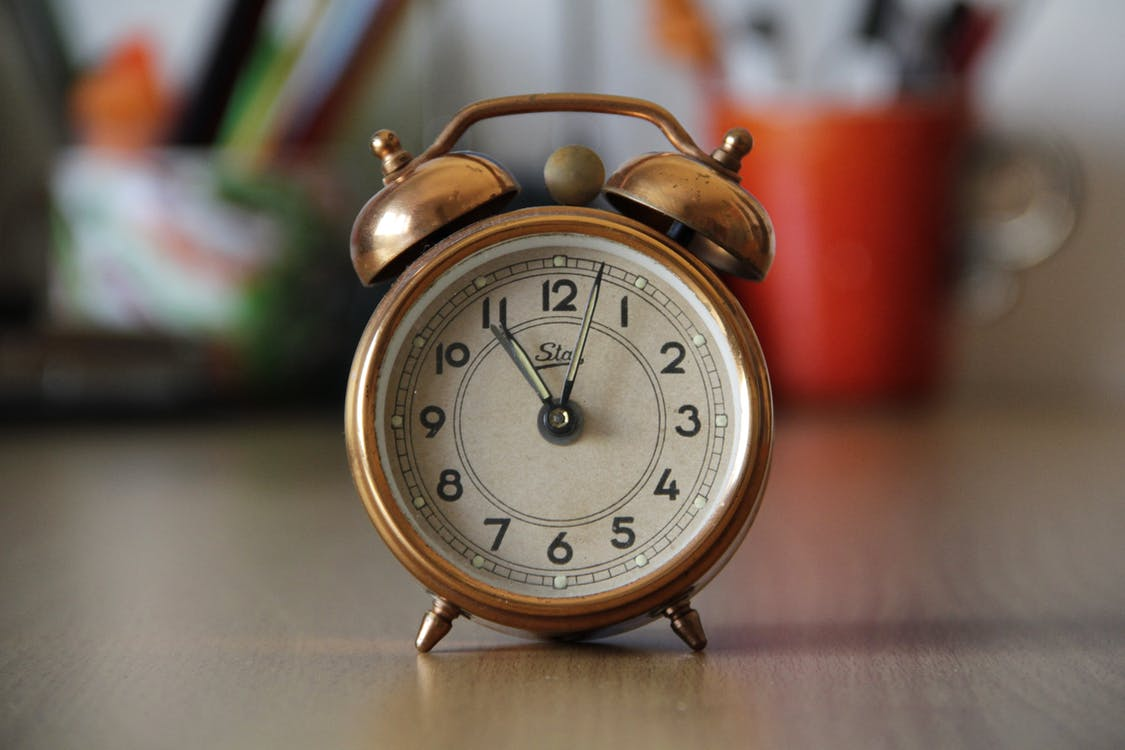 Focus Photography of Brown Double Bell Alarm Clock