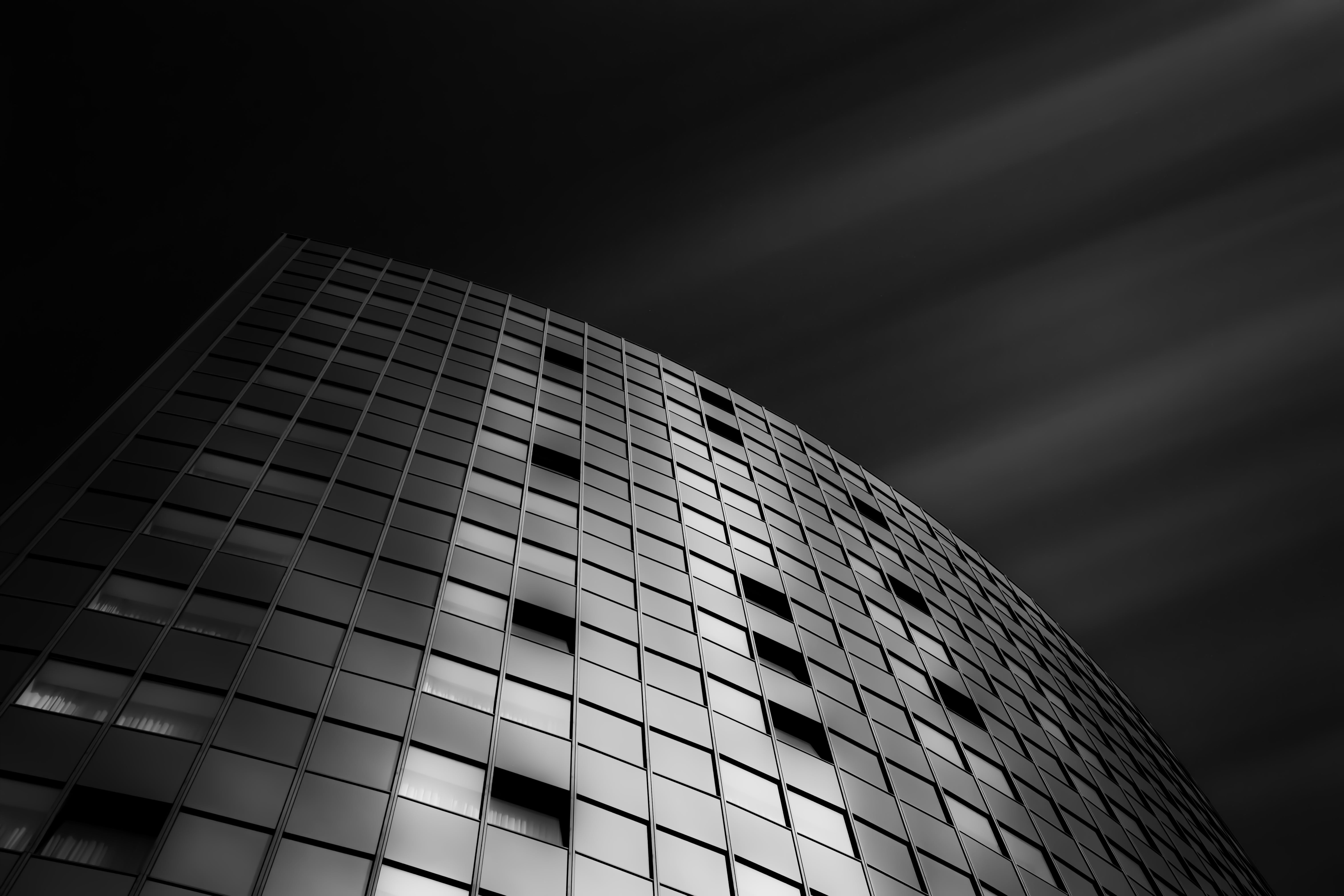 Low-angle Grayscale Photography of Curtain-wall Building