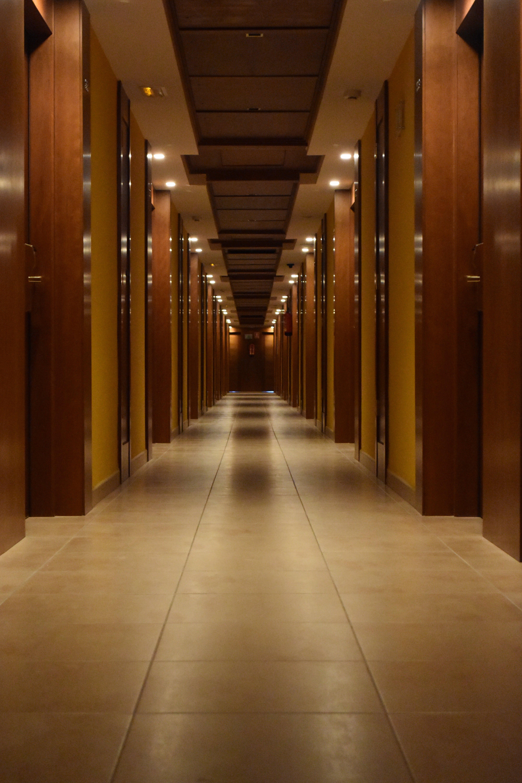 Beige Ceramic Tiled Corridor Inside Building