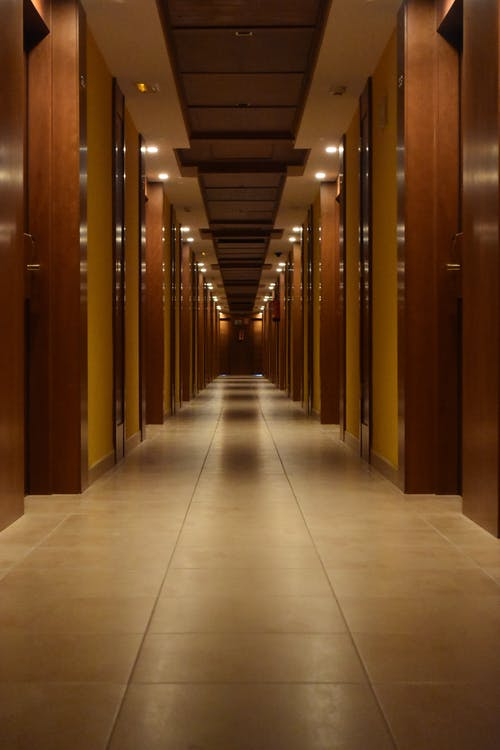 Beige Ceramic Tiled Corridor Inside Building