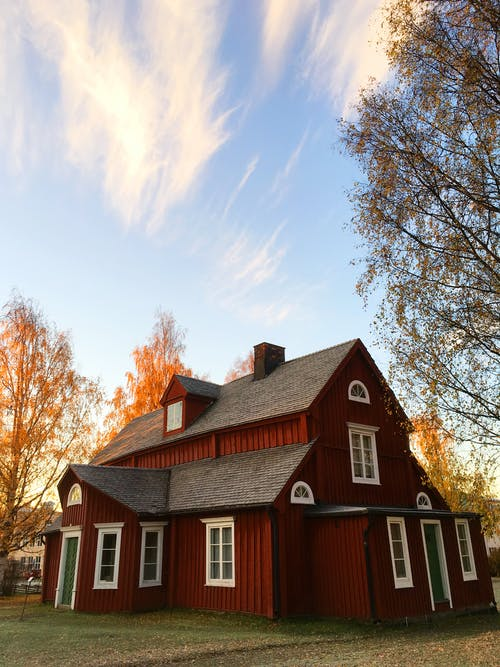 Red and Black Wooden House Under Blue Sky