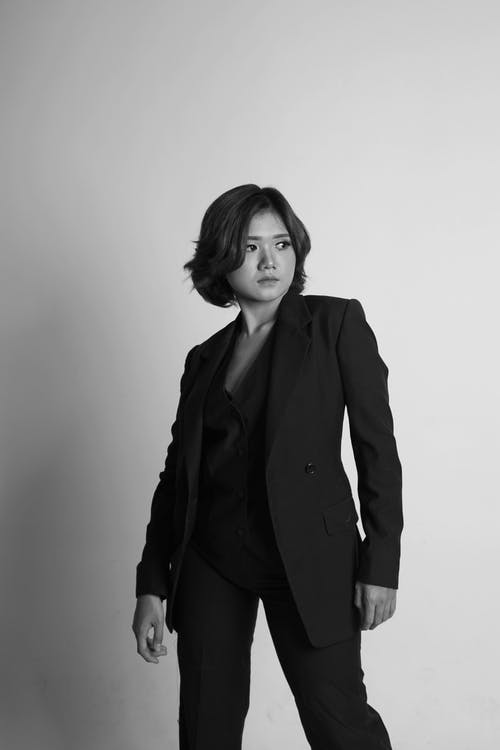Grayscale Photo of Woman in Suit Jacket