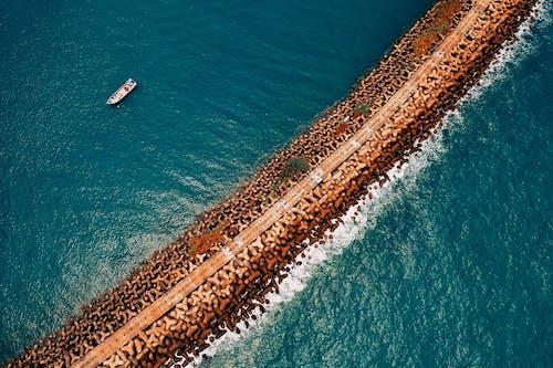 Photos gratuites de bord de mer, cailloux, côte, côte rocailleuse