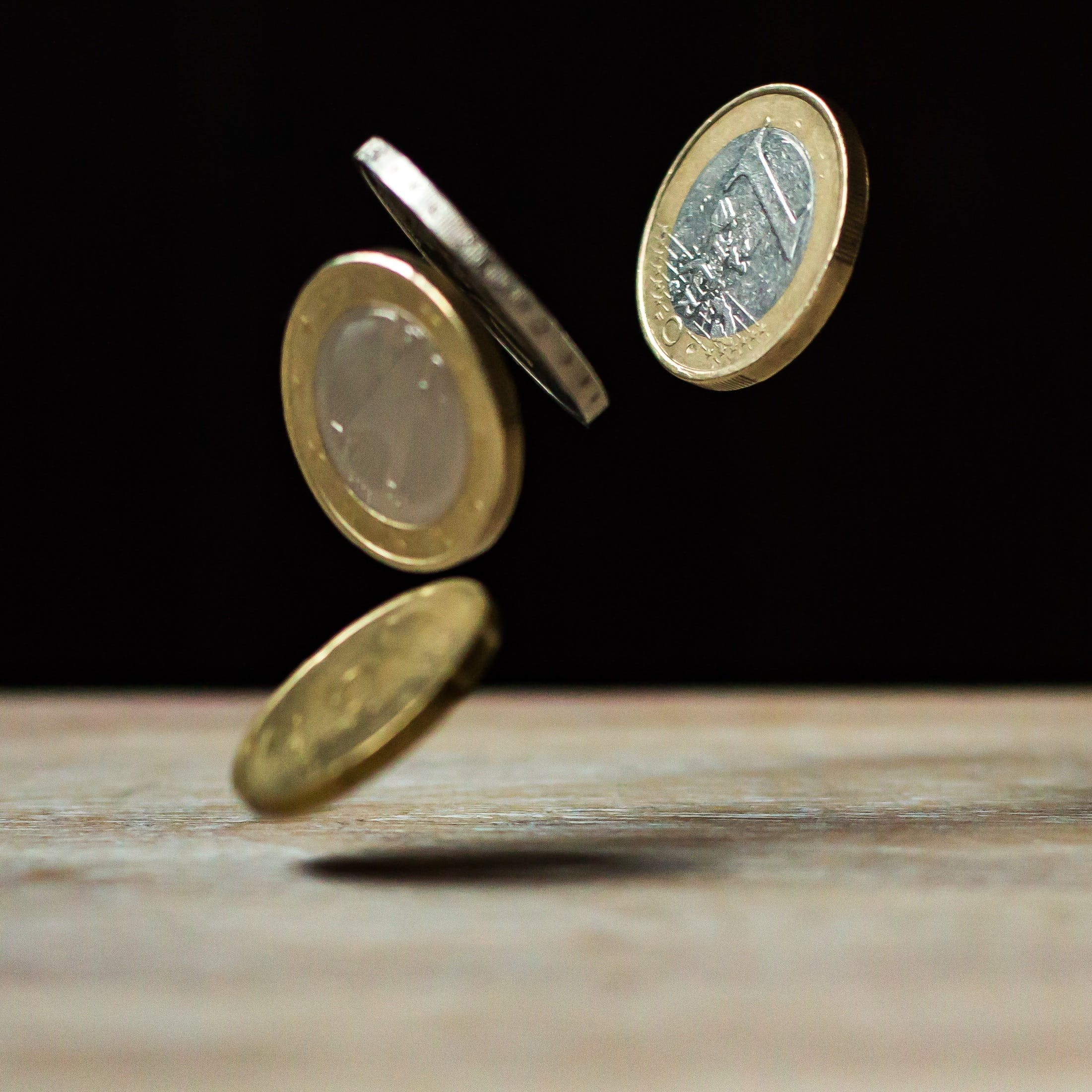 Coins on Brown Wood