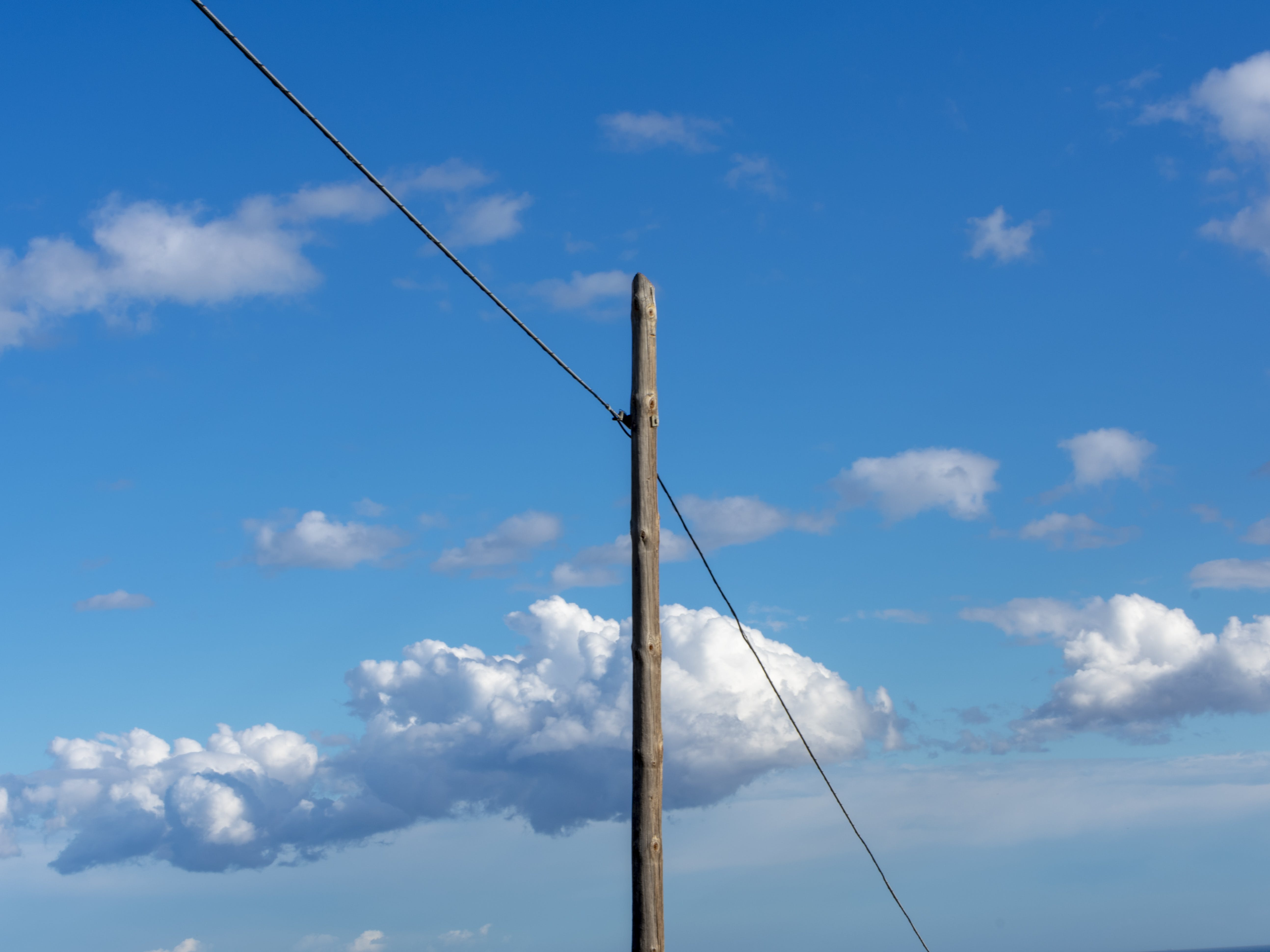 Free stock photo of blue sky, electric pole, white clouds