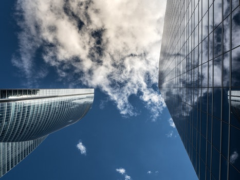Worm's Eye View of High Rise Building Under White Cloudy Sky