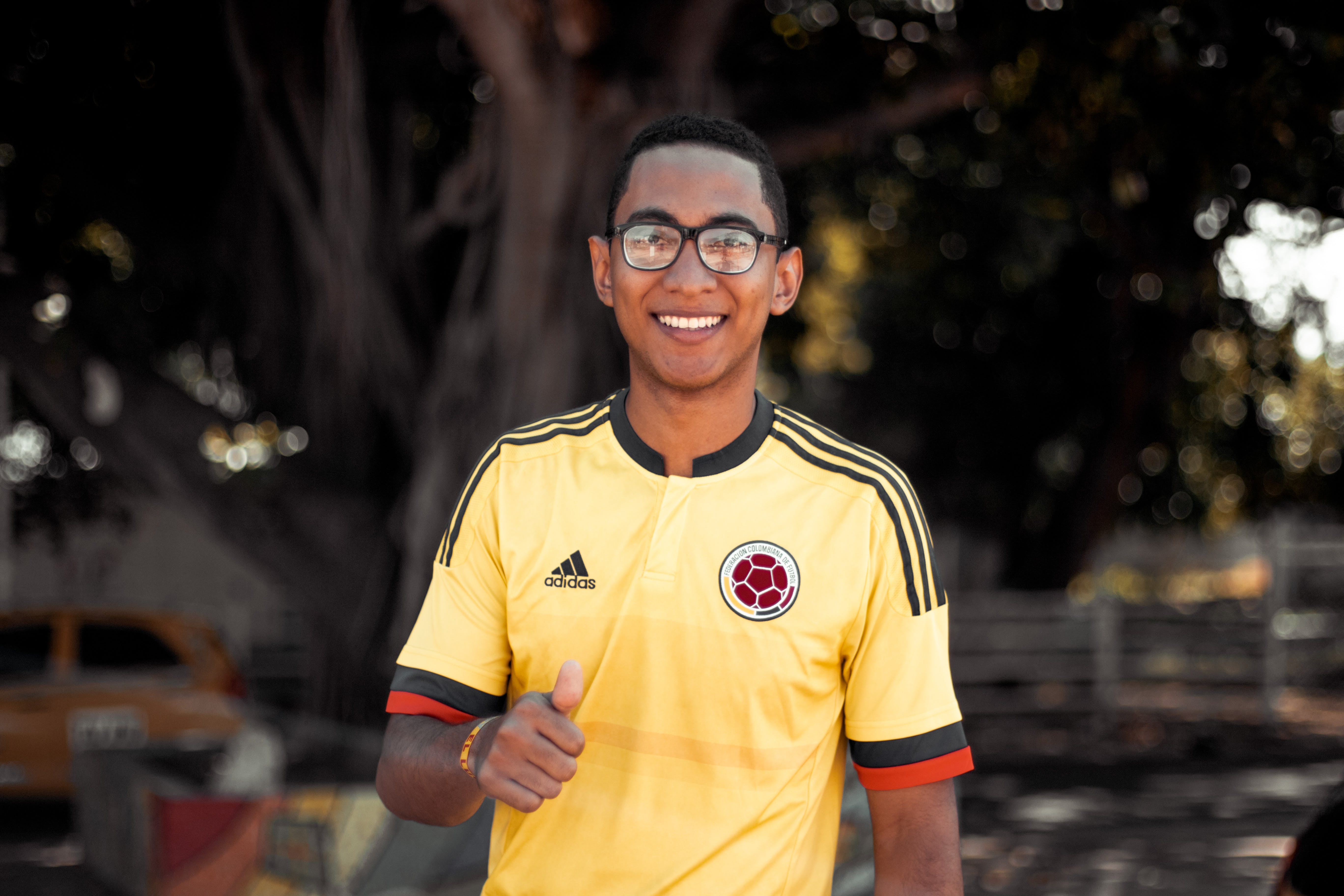 Man Wearing Yellow and Black Adidas Jersey Shirt