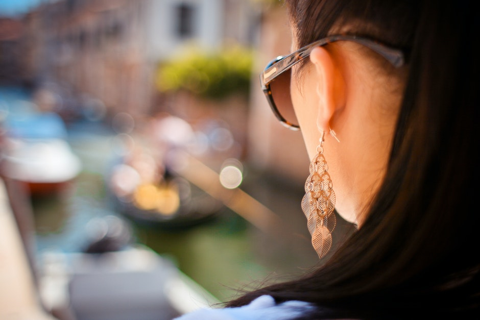 Woman Wearing Pendant Earrings and Sunglasses