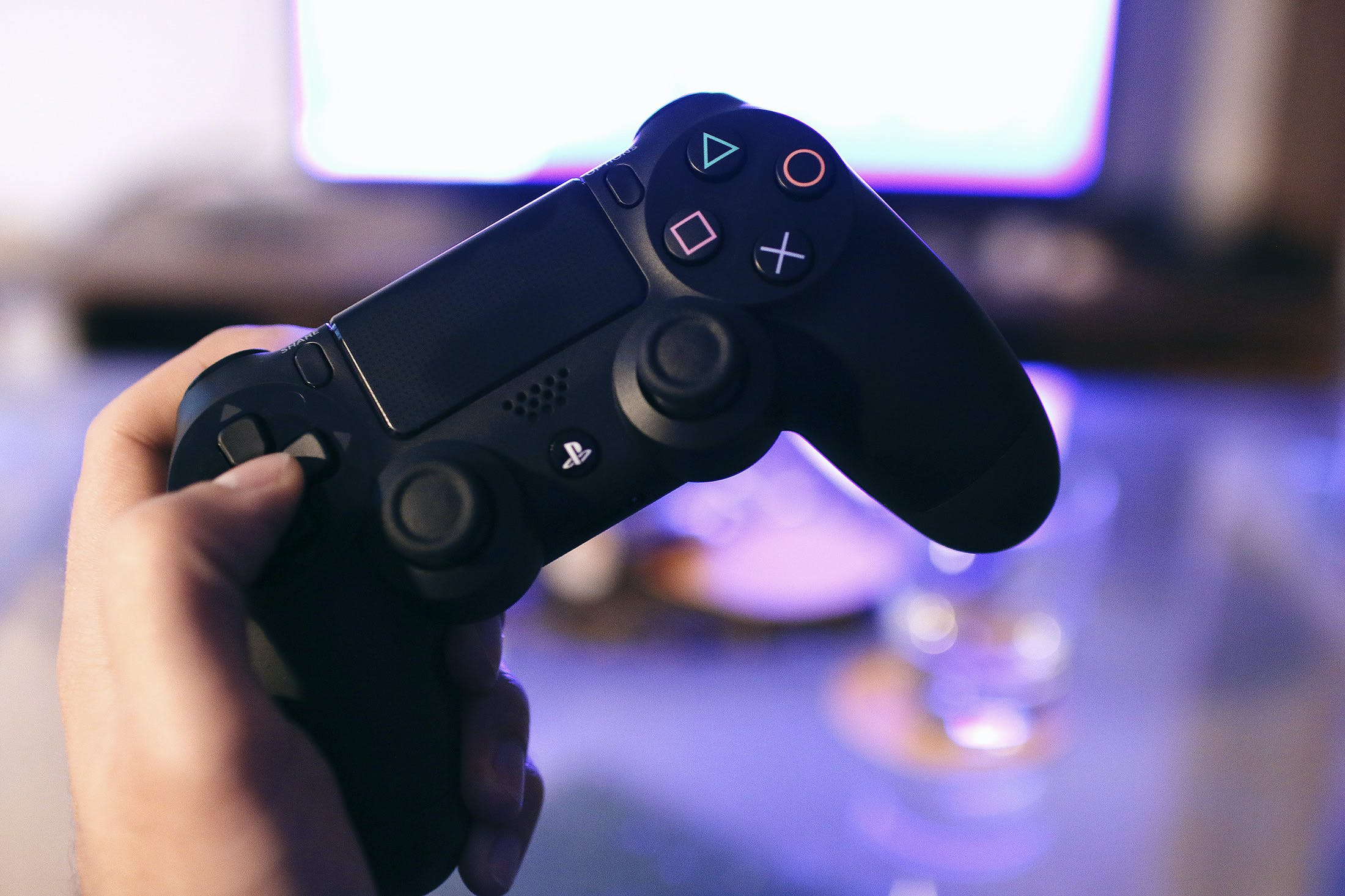 Person Holding Sony Ps4 Dualshock 4