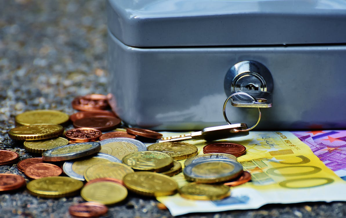Banknotes and Coins Beside Gray Safety Box