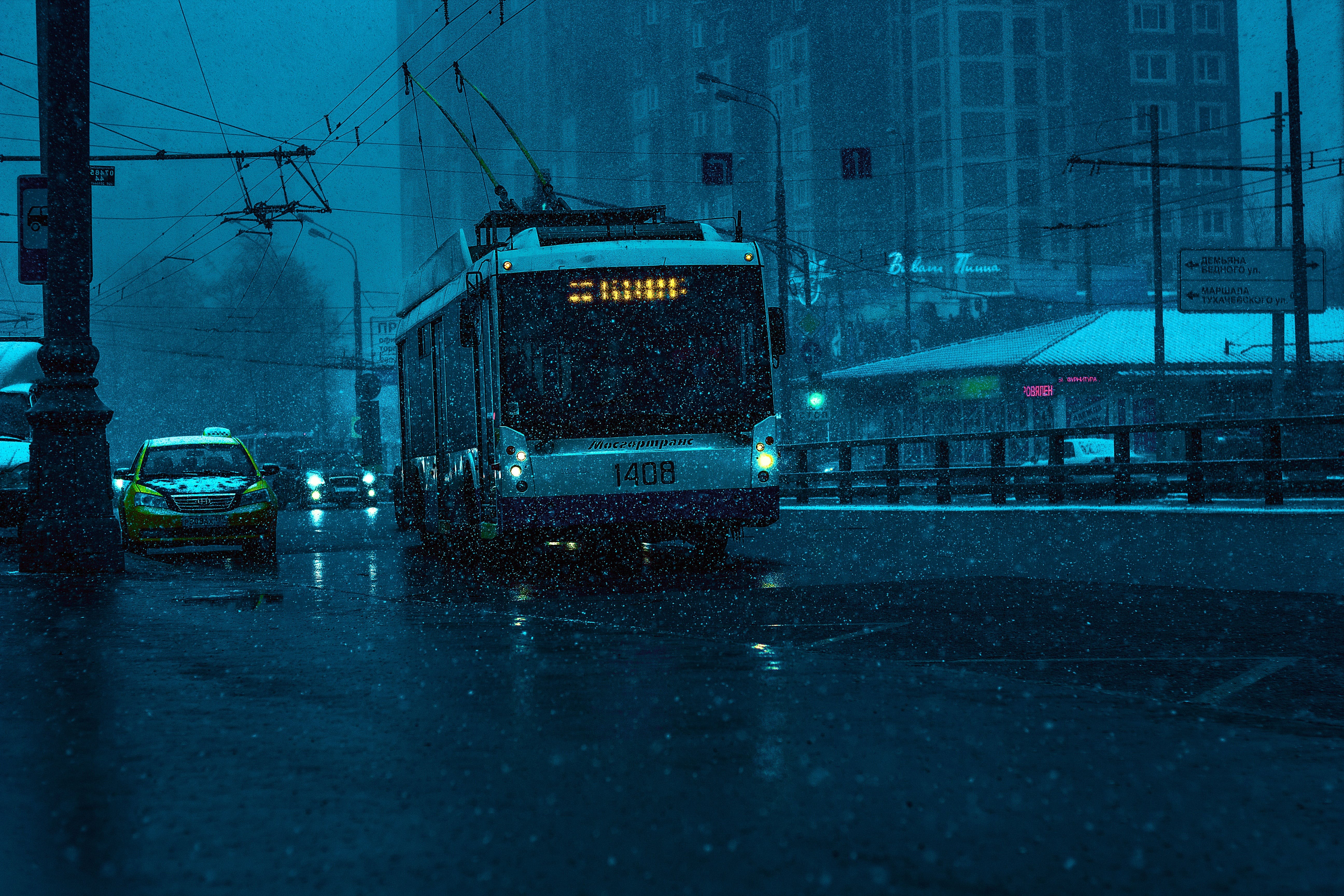 Bus and Gray Car on Road While Raining in City