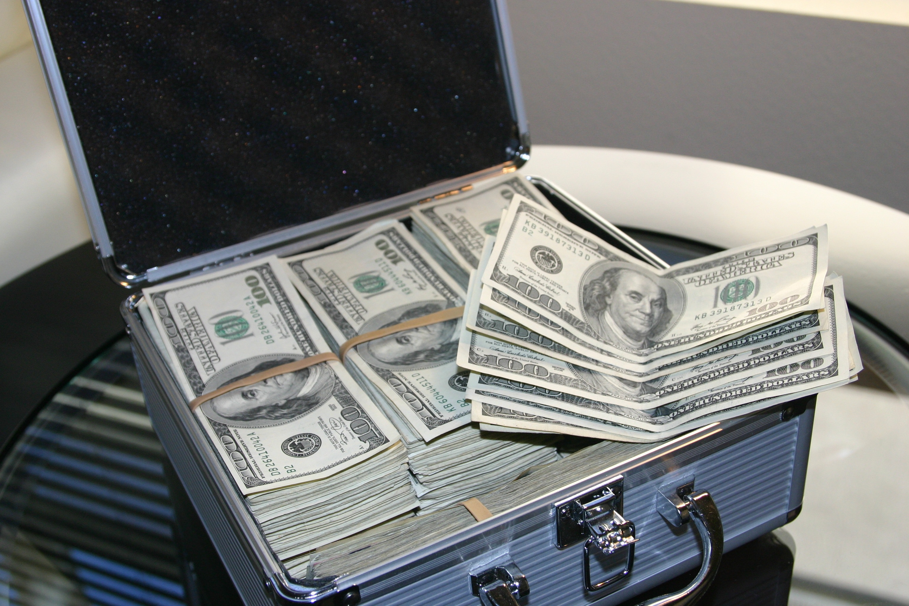 Image result for suitcase of money